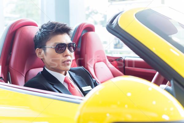 Asian man testing new sports car Stock photo © Kzenon