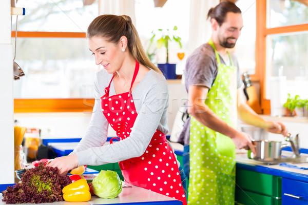 Couple cooking in domestic kitchen healthy food Stock photo © Kzenon