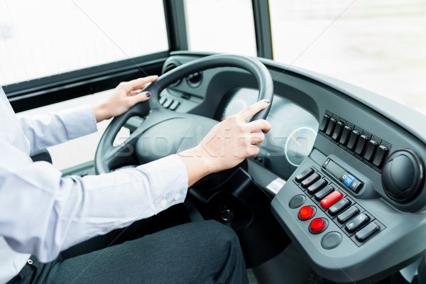 Bus driver in cockpit at the wheel driving Stock photo © Kzenon