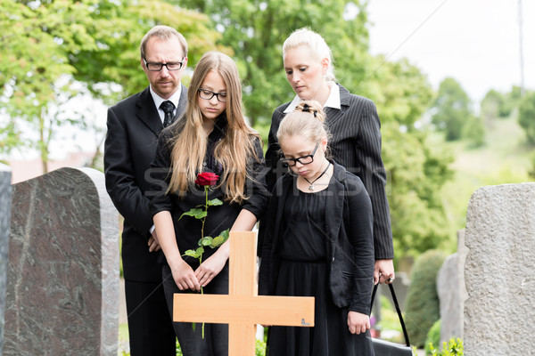 Family mourning at grave on cemetery Stock photo © Kzenon