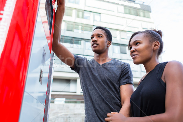 Low-angle view of young African American couple at an automatic  Stock photo © Kzenon
