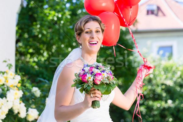 Bride at wedding with read helium balloons Stock photo © Kzenon