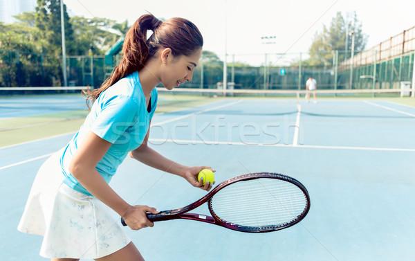 Profissional feminino jogador sorridente tênis Foto stock © Kzenon