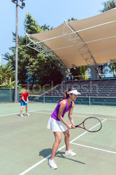 Confident female tennis player waiting to hit the ball during do Stock photo © Kzenon