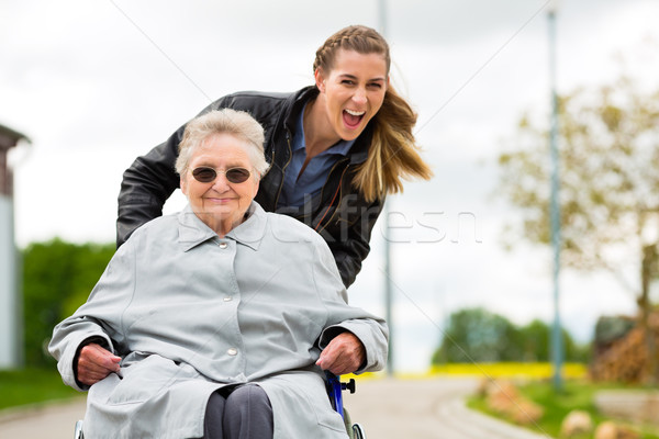 woman visiting her grandmother  Stock photo © Kzenon