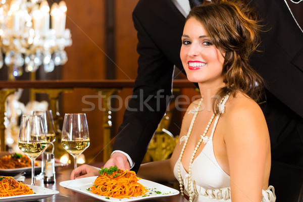 Beautiful woman and waiter in fine dining restaurant Stock photo © Kzenon