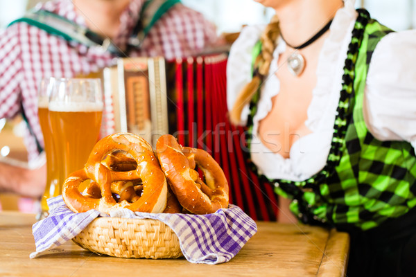 Bavarian restaurant with beer and pretzels Stock photo © Kzenon