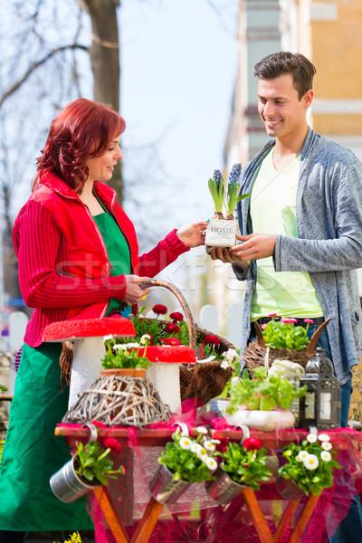 Costumer buying flower in flower shop Stock photo © Kzenon