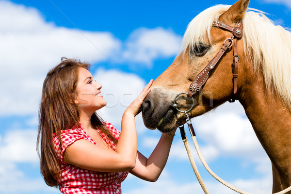 Woman petting horse on pony farm Stock photo © Kzenon