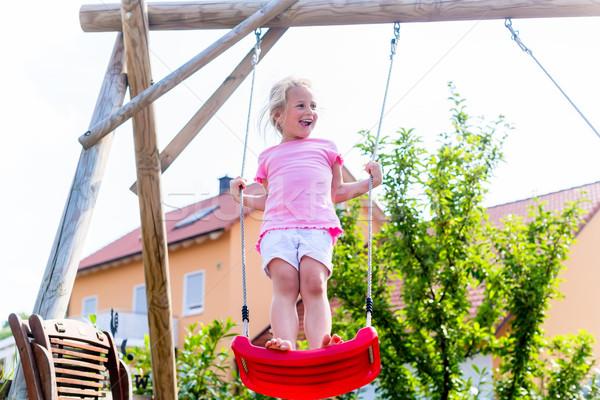 девочку Swing дома ребенка саду весело Сток-фото © Kzenon