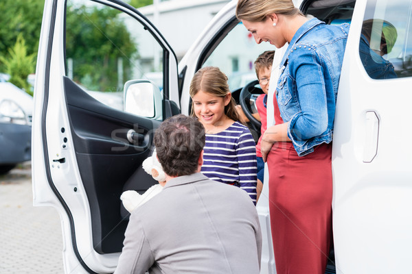 Family buying car, mother, father and child at dealership Stock photo © Kzenon