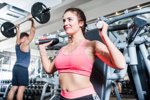 Woman and man having sport training in fitness gym Stock photo © Kzenon