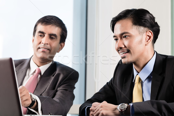 Senior manager and junior professional having meeting  Stock photo © Kzenon
