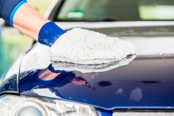 Close-up of hand wiping car with microfiber wash mitt Stock photo © Kzenon