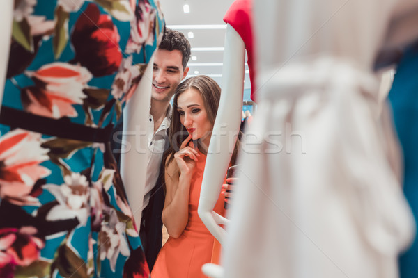 Kobieta człowiek patrząc suknie manekin moda Zdjęcia stock © Kzenon