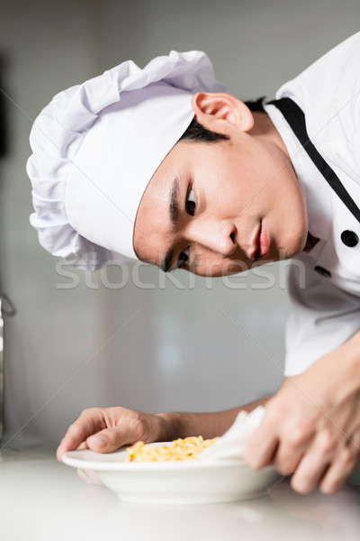 Asian chef plating up a bowl of food Stock photo © Kzenon