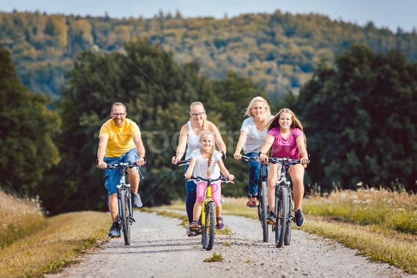 Család lovaglás biciklik délután vidék nyár Stock fotó © Kzenon
