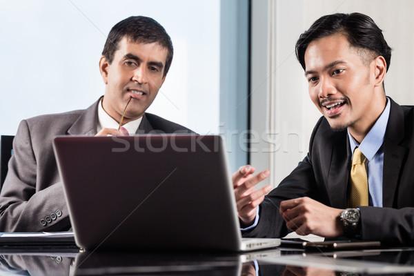 Senior manager and junior professional having meeting  Stock photo © Kzenon