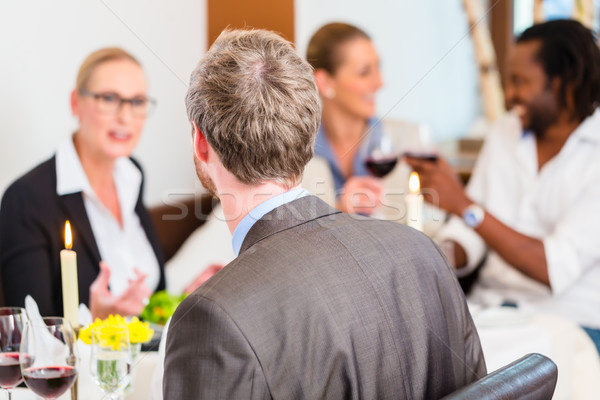 Business lunch in restaurant with food and wine Stock photo © Kzenon