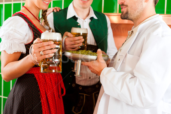 Couple with beer and their brewer in brewery Stock photo © Kzenon