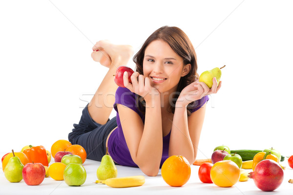 Healthy nutrition - young woman with fruits Stock photo © Kzenon