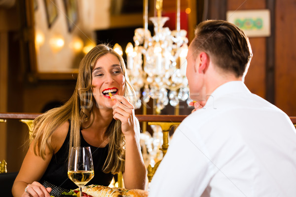 happy couple in restaurant eat fast food Stock photo © Kzenon