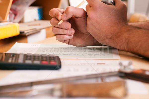 Carpenter planning his work  Stock photo © Kzenon