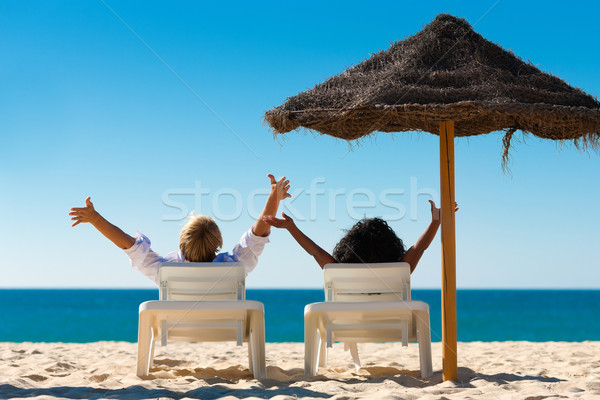 Happy couple on beach Stock photo © Kzenon