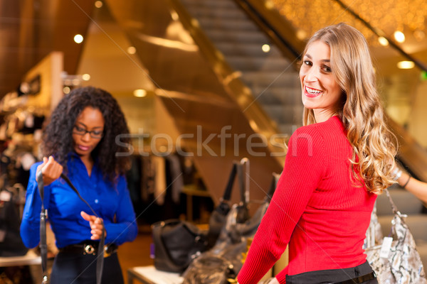 Women in a shopping mall with  Stock photo © Kzenon