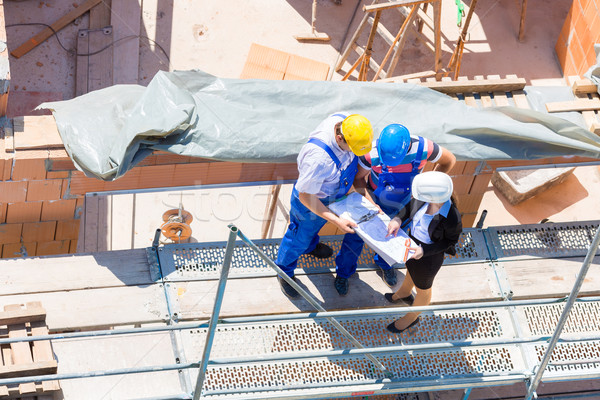 Stock photo: Team discussing construction or building site plans