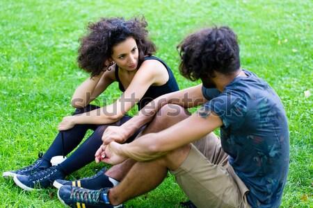 Latin Hipster couple sitting on meadow Stock photo © Kzenon