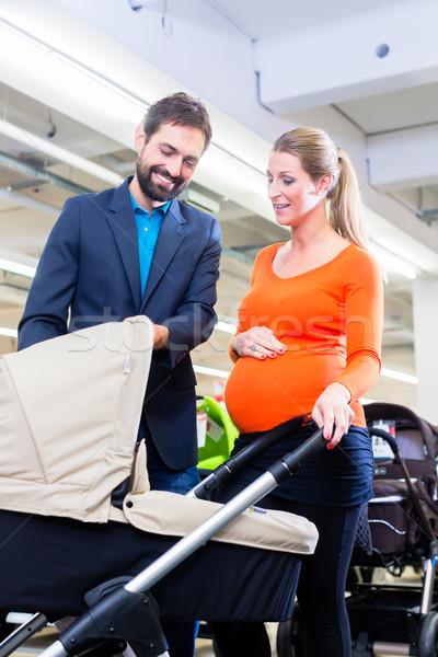 Couple in baby shop buying stroller Stock photo © Kzenon