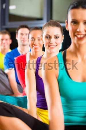 Men and women doing fitness spinning for sport Stock photo © Kzenon