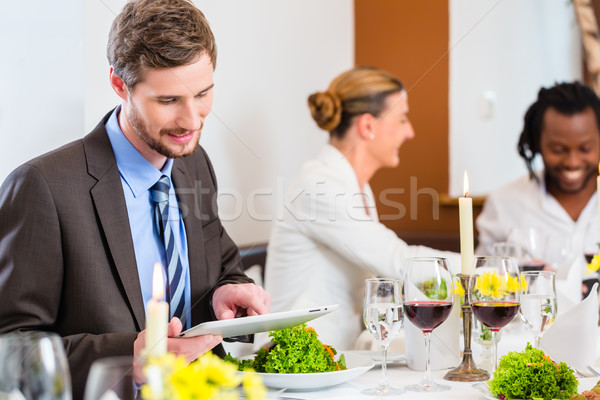 Stock photo: Man on business lunch with tablet computer