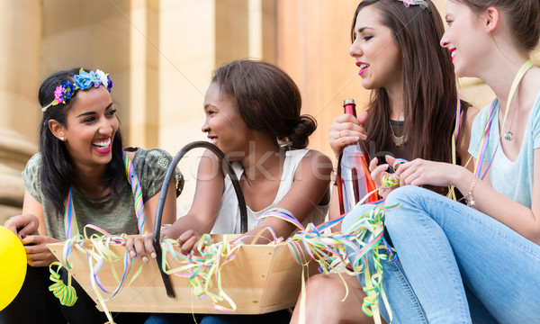 Girls having drink together on bachelorette party Stock photo © Kzenon