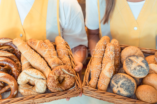 Stock photo: Sales women in bakery presenting fresh bread