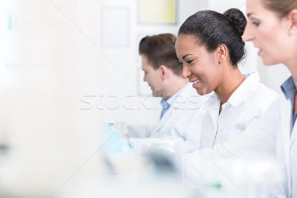 Grup çalışmak laboratuvar gülen adam Stok fotoğraf © Kzenon