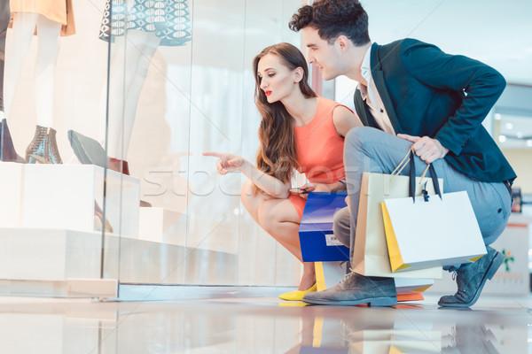 Woman and man looking at fashion shop window Stock photo © Kzenon