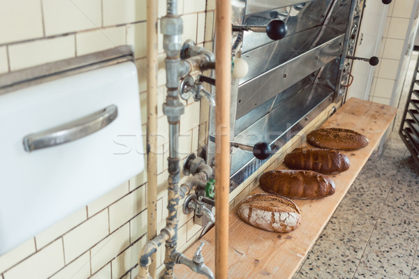 Loafs of bread waiting on shelf in bakery to be sold Stock photo © Kzenon