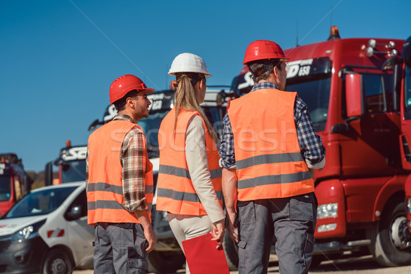 Driver and booker of heavy transport cargo company  Stock photo © Kzenon