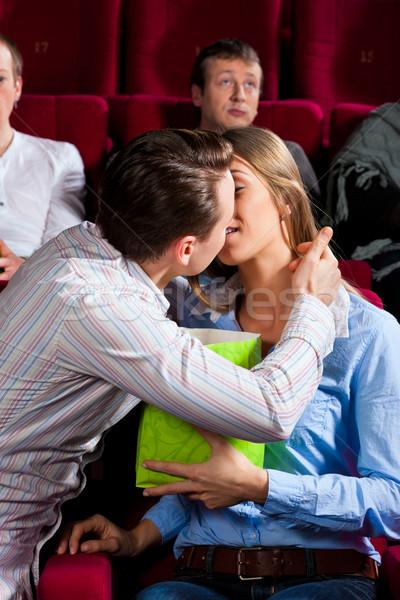 Couple in cinema with popcorn kissing Stock photo © Kzenon