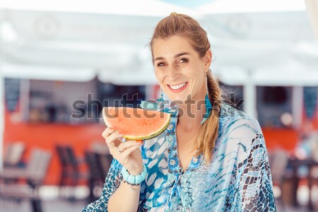 Woman with traditional Bavarian clothes or dirndl in beer tent Stock photo © Kzenon