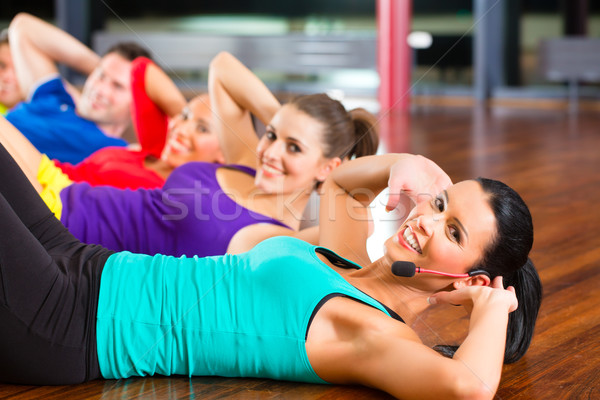 Stock photo: Fitness group in gym doing crunches for sport