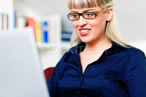 Woman telecommuting using laptop  Stock photo © Kzenon