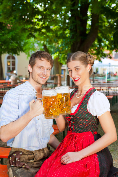 Couple with beer stein and traditional clothes Stock photo © Kzenon