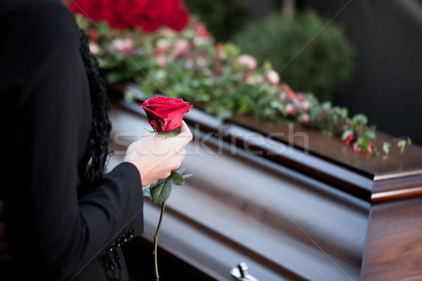 Stock photo: Woman at Funeral with coffin