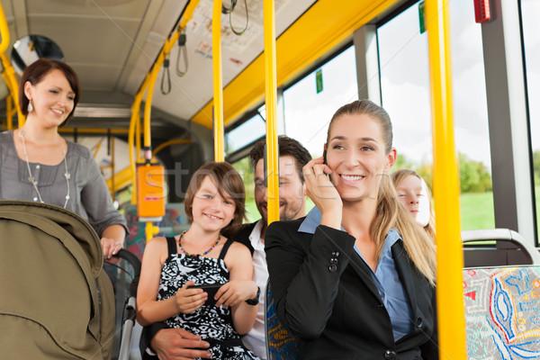Utasok busz ingázó nő baba nők Stock fotó © Kzenon