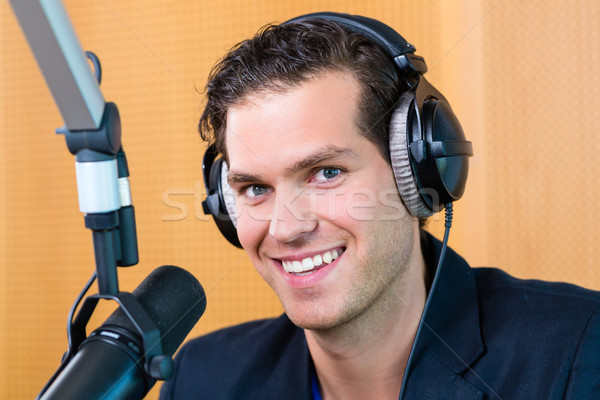 Radio presenter in radio station on air Stock photo © Kzenon