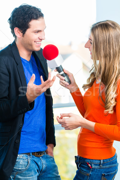 Radio host in radio stations with interview Stock photo © Kzenon