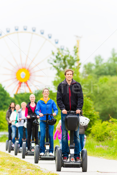 Tourists having Segway sightseeing Stock photo © Kzenon